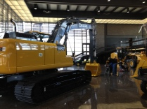 210G Excavator on display floor